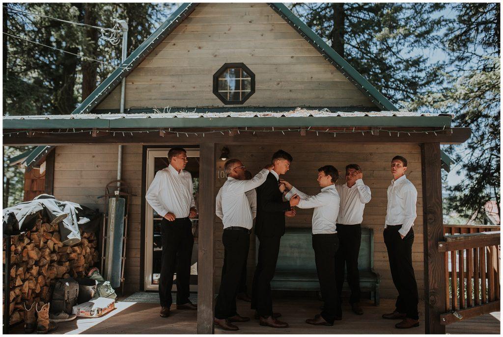Groomsmen getting ready for a summer boho wedding in McCall Idaho