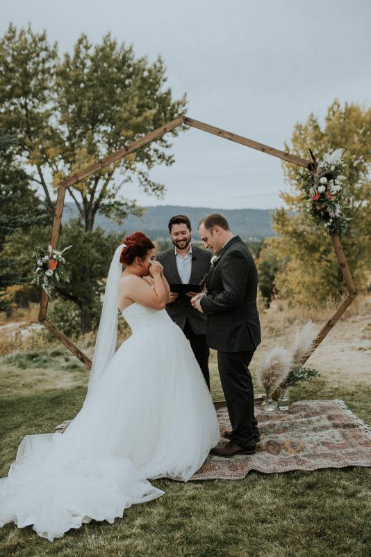 Amazing fall wedding for a bride and groom who share an emotional moment sharing their vows in McCall Idaho