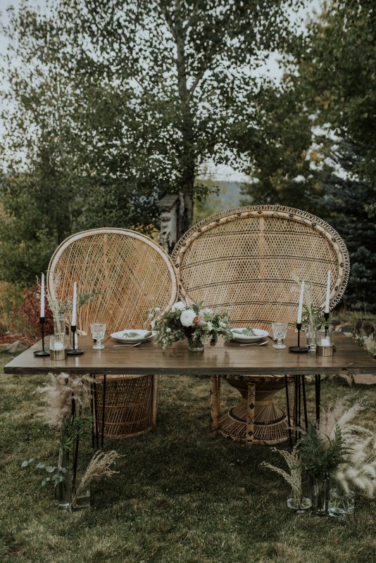 Amazing boho sweetheart table for a bride and groom in McCall Idaho
