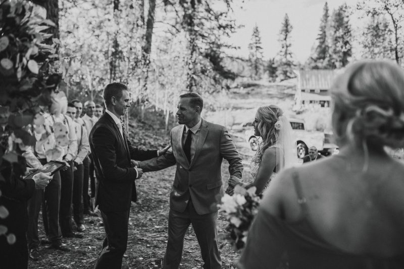 Emotional bride walks down the aisle to her groom in Boise Idaho fall wedding.